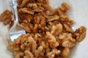 Toss the walnuts with the sugar mixture.